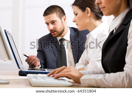 Business people team working in the office with laptop - stock photo
