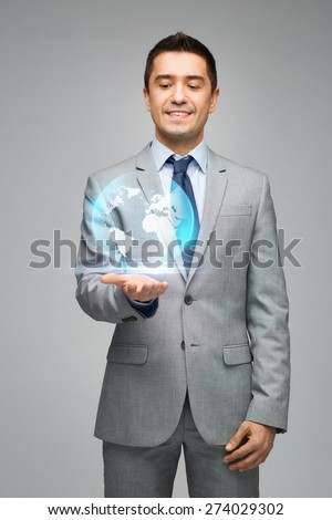 business, people, technology and global communication concept - happy businessman in suit showing globe hologram over gray background - stock photo