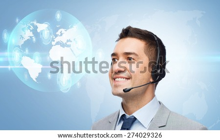 business, people, technology and service concept - smiling businessman in headset looking to virtual contacts icons projection over blue background - stock photo