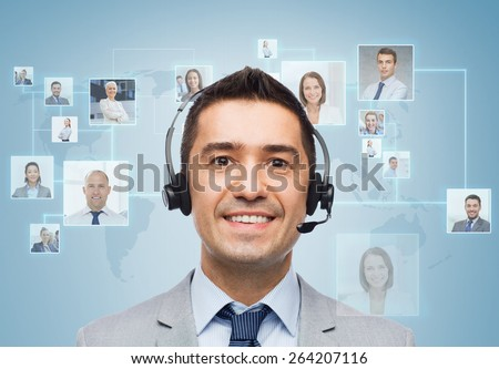 business, people, technology and service concept - smiling businessman in headset over virtual contacts icons projection and blue background - stock photo