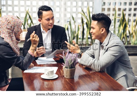 business people technology and teamwork concept - smiling businessman and businesswomen with tablet pc computer meeting in cafe - stock photo