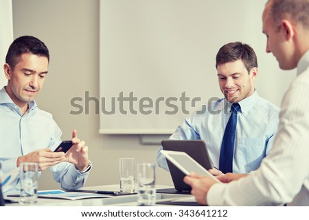 business, people, technology and teamwork concept - smiling businessmen with smartphone and tablet pc computers meeting in office - stock photo