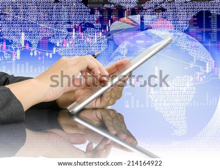 Business people touch tablet and hold the pen in hand  on stock background - stock photo