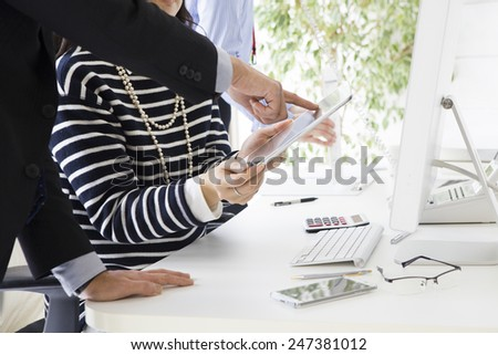Business people using an electronic terminal at an office - stock photo
