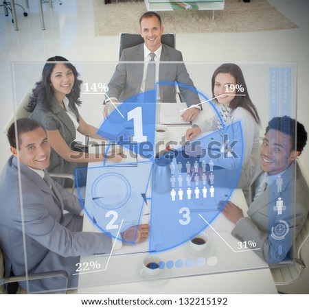 Business people using blue pie chart interface at board meeting - stock photo