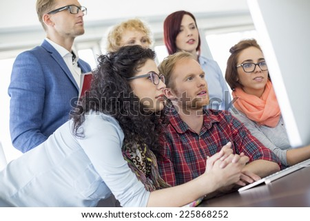 Business people using computer in office - stock photo