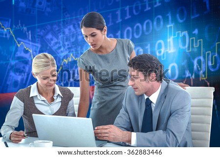 Business people using laptop against stocks and shares
