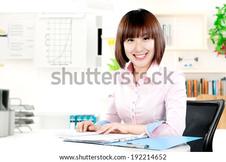 Business people using laptops in the office - stock photo