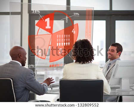 Business people using red pie chart interface in their meeting - stock photo
