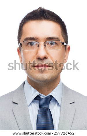 business, people, vision and office concept - happy smiling businessman in eyeglasses and suit - stock photo