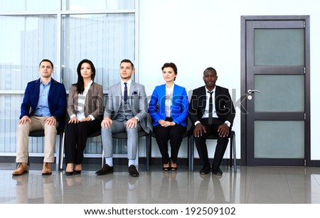 Business people waiting for job interview. Five candidates competing for one position - stock photo