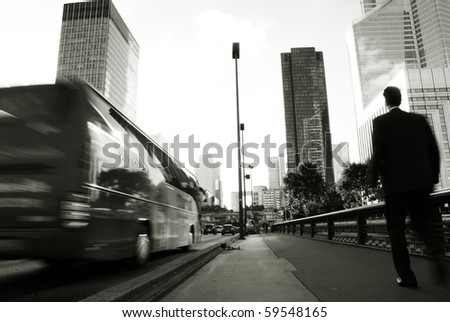 Business people walking along traffic and building center - stock photo