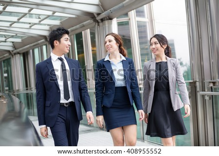 Business people walking at street