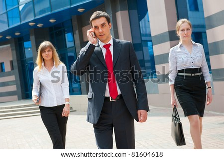 Business people walking in modern city downtown - stock photo