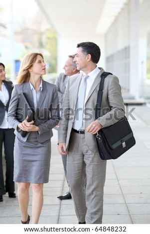 Business people walking outside a congress center - stock photo