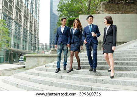 Business people walking together on street - stock photo