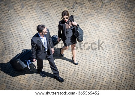 Business People Walking with Trolley Bag, Aerial View - stock photo