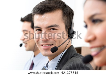 Business people wearing microphone headset - telemarketing, operator, call center and customer service concepts - stock photo