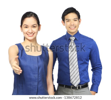 Business people welcoming a visitor or new team member  - stock photo