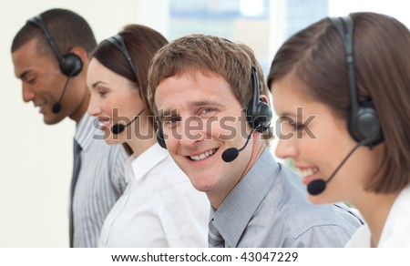 Business people with headset on in a call center - stock photo