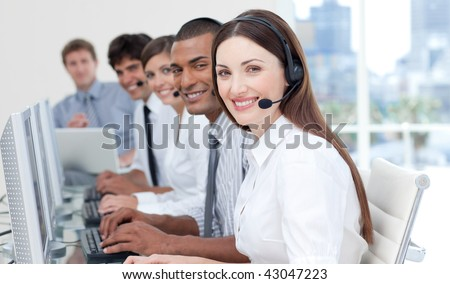 Business people with headset on working in a call center - stock photo