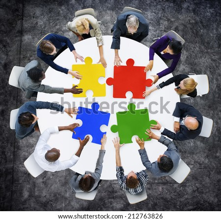 Business People with Jigsaw Pieces for Connection Concept