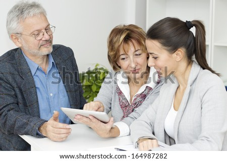 Business people working around the desk. - stock photo