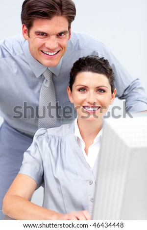 Business people working at a computer in the office