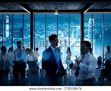 Business People Working in a Conference Room with City Skyline - stock photo