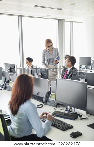 Business people working in an open plan office - stock photo