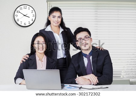 business people working in diversity with laptop - stock photo