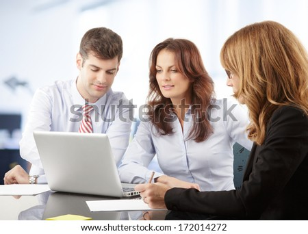 Business people working in group in the office - stock photo