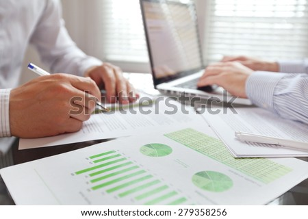 business people working in the office, focus on foreground - stock photo