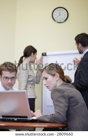 Business people working in the office - 2 man, 2 woman - stock photo