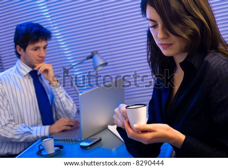 Business people working late at office. - stock photo