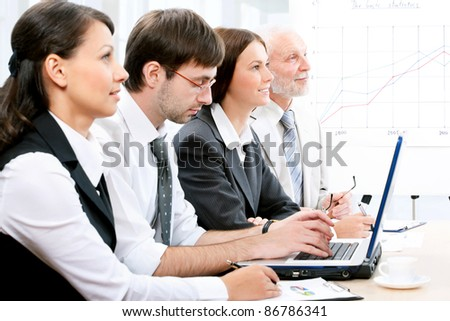Business people working on the conference - stock photo