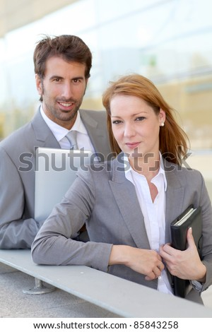 Business people working outside on electronic tablet - stock photo