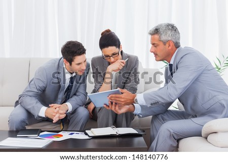 Business people working together on sofa at office