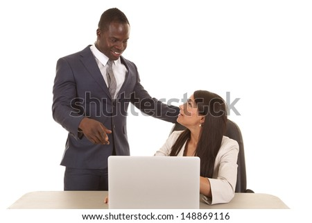 Business people working together on the laptop with smiles on their faces. - stock photo