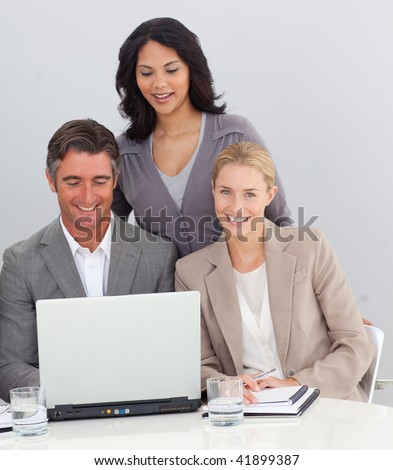 Business people working with a laptop in the office - stock photo