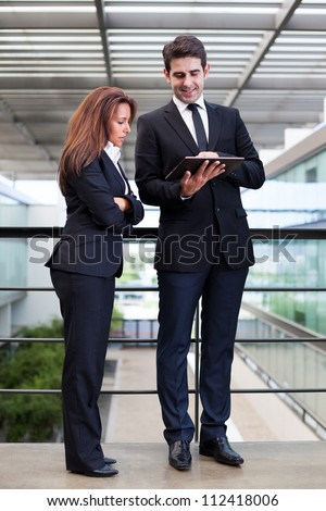 Business people working with electronic tablet