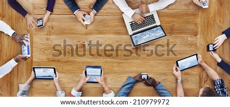 Business People Working with Technology - stock photo