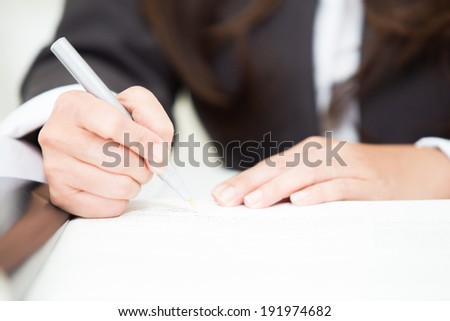 business people writing approval contract  - stock photo