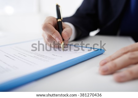 Business person filling contract, selective focus