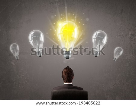 Business person having an bright idea light bulb concept - stock photo