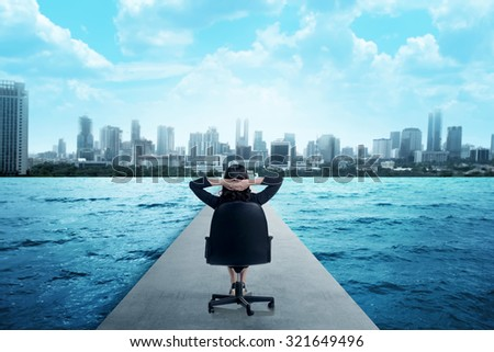Business person on the street to the city with water on the side - stock photo