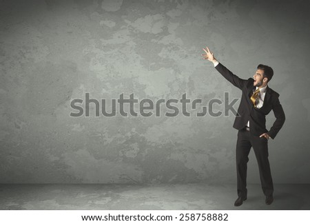 Business person throwing with empty copyspace in a room - stock photo