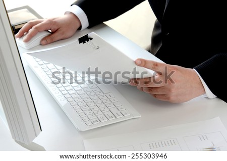 Business person using pc in office - stock photo