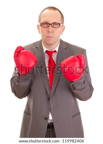 Business person with boxing gloves - stock photo