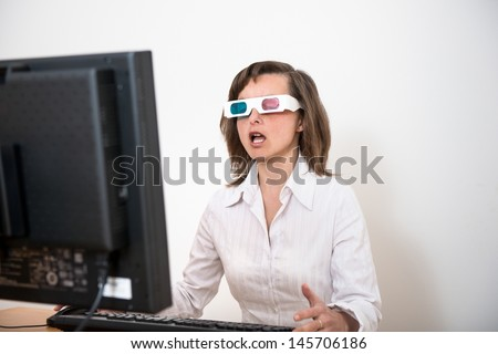 Business person  with 3d glasses at computer - awe expression